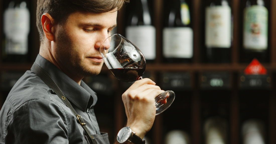 sommelier smelling glass of wine
